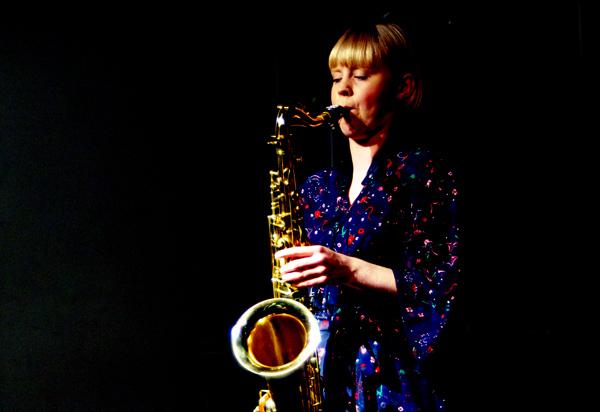 Helena Kay playing sax